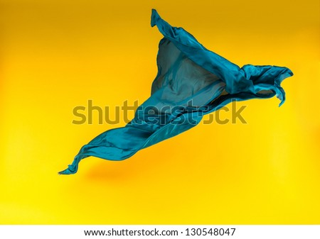 abstract pieces of fabric flying high-speed studio shot