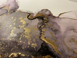 Abstract pink art with gold — pink-purple background, beautiful smudges and stains made with alcohol ink and golden pigment. Pink fluid art texture resembles petal, flower, watercolor or aquarelle.