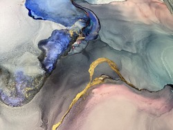 Abstract pink-blue background with beautiful smudges and stains made with alcohol ink and gold pigment. Fragment of art with texture resembles watercolor or aquarelle painting.