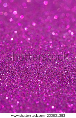 Abstract pink glitter festive background texture with shining glitter stars. Full frame fuchsia color christmas detail with blurred areas. Artistic colorful background drop frame.
