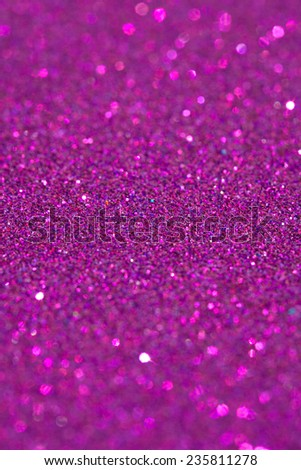 Abstract pink glitter festive background texture with shining glitter stars. Full frame fuchsia color christmas detail with blurred areas. Artistic colorful background drop frame space.
