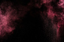 Abstract pink paint Holi. Abstract pink powder explosion on black background.