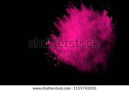 Abstract pink powder explosion on black background. abstract colored powder splatted, Freeze motion of pink powder exploding.