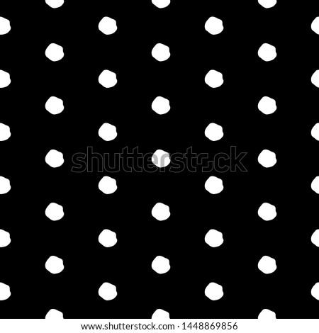 Abstract polka dot pattern with hand drawn dots. Funny raster black and white polka dot pattern. Seamless monochrome doodle polka dot pattern for textile, wallpapers, wrapping paper, cards and web.