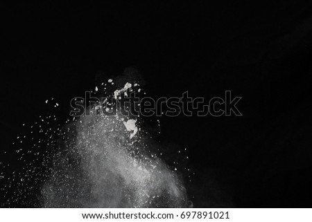 abstract powder splatted background,Freeze motion of color powder exploding/throwing color powder,color glitter texture on black background   - Shutterstock ID 697891021