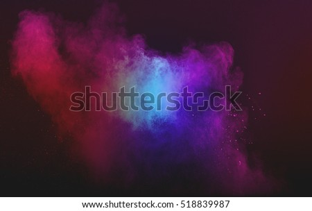 abstract powder splatted background. Powder explosion on black background. Colored cloud. Colorful dust explode. #518839987