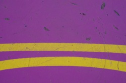 Abstract purple background with double yellow curve lines across lower part of picture with space for runaround or wraparound text