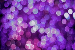 Abstract purple bokeh background. Holiday sparkly pink booked light background.
