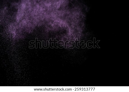 Abstract purple  paint Holi. Abstract purple powder explosion on black background.