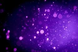 Abstract purple , violet bokeh on black