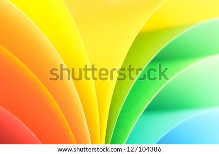 Abstract rainbow background with colored paper.Light tones.