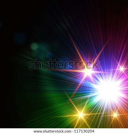 abstract rainbow colorful rays lights like stars over black background, lens flare