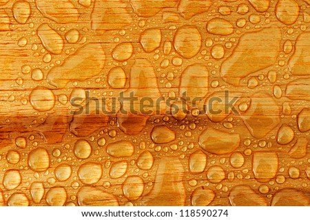 abstract raindrops pattern on wooden board