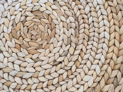 Abstract rattan texture. Background with round large weaving of straw. Textured bamboo background.
