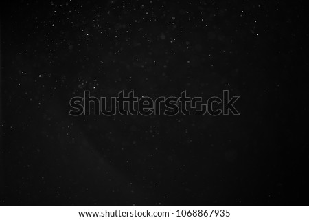 abstract real dust floating over black background for overlay #1068867935