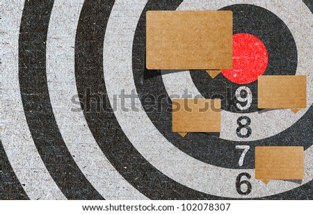 Abstract recycled paper craft , red target, note