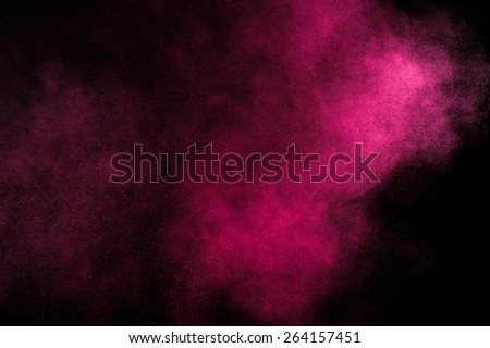 Abstract red and pink paint Holi. Abstract red and pink powder explosion on black background.