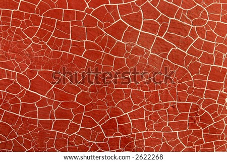 Abstract red background.  A boat hull with red paint and white cracked lines.
