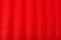 Abstract red background with vertical lines. Textured background with copy space. Corrugated paper top flat lay, concept of template for website or banner design