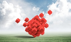 Abstract red cubes on green meadow. Digital technology and innovation solutions. New approach to business management. Nature landscape with green grass and blue sky. Mixed media with 3D object