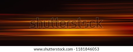 Photo of  Abstract red light trails in the dark background