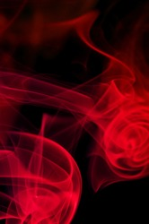 abstract red smoke . black background