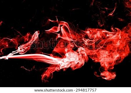 Abstract red smoke on black background, smoke background,colorful ink background,red  fire,beautiful color smoke #294817757
