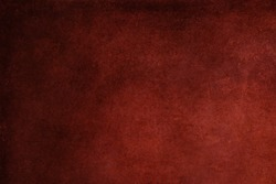 Abstract red stained paper texture background or backdrop. Empty old red paperboard or grainy cardboard for decorative design element. Simple monochrome surface for journal template presentation.