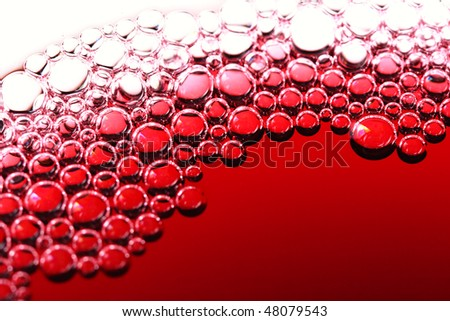 abstract red wine bubbles, close-up shot