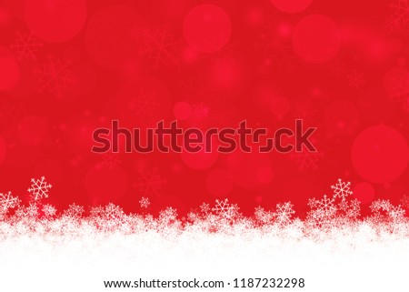 Abstract red Xmas background with snowflakes and bokeh light for winter season and Christmas day concept