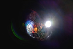 Abstract reflection light from shining disco mirror ball. Dancing party and holiday event background.