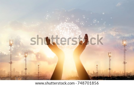 Abstract science. Businessman touching circle global network connection and data exchanges worldwide on city sunset background. Networking and technology concept