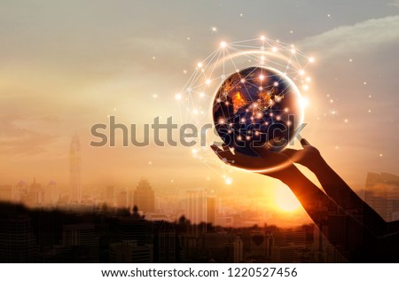 Abstract science, hands touching earth and circle global network connection communication on sunset background, technology and innovation. Elements of this image furnished by NASA #1220527456