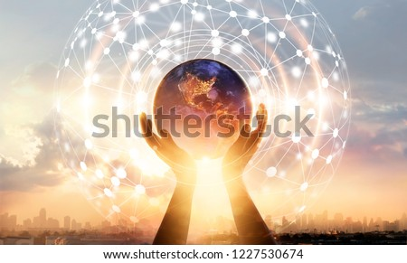 Abstract science. Hands touching earth and circle global network connection, data exchanges worldwide on city sunset background. Innovation. Creative and inspiration idea and Networking