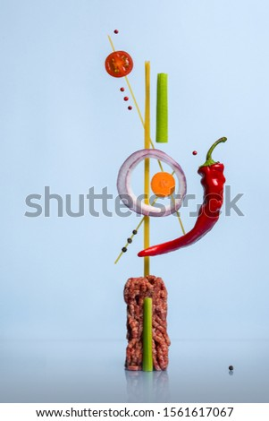 Abstract sculpture with fresh cooking ingredients for spicy food. Concept of modern molecular cuisine or haute cuisine. Creative restaurant meal concept.