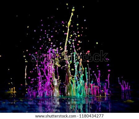 Abstract sculptures of colorful splashes of paint. Dancing liquid on a black background. Ink water splash. Color explosion.  #1180434277