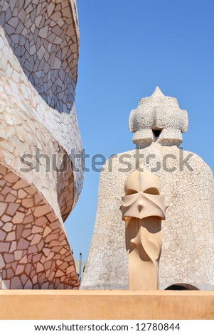 abstract sculptures on the roof La Pedrera (Milà House) in Barcelona, Spain created by Antonio Gaudi. These sculptures are the chimneys of the apartment building