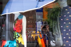 Abstract self portrait in window of the clothes shop