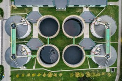 Abstract sendimentation tank of ironworks water treatment plant in Silesia Poland aerial drone photo view