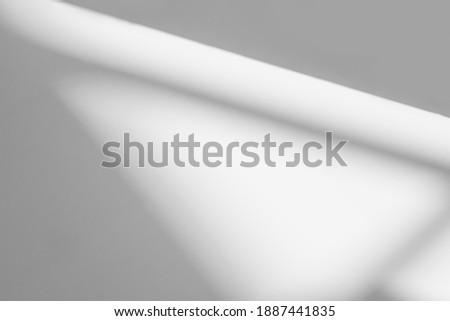 Abstract shadow and striped diagonal light background on white wall  from window,  architecture dark gray and sunshine diagonal geometric effect overlay for backdrop and mockup design