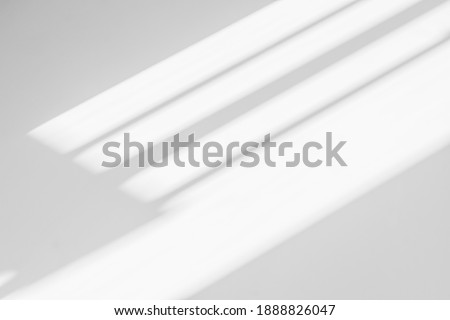 Abstract shadow and striped diagonal light background on white wall  from window,  architecture dark gray and sunshine diagonal geometric effect overlay for backdrop and design