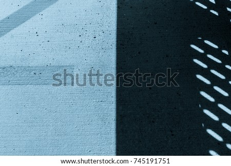 Abstract shadow on concrete floor. Parking line on ground. Shadow on cement stone floor. Pavement with shadow and yellow line on ground. Abstract industrial design. Abstract minimal design.
