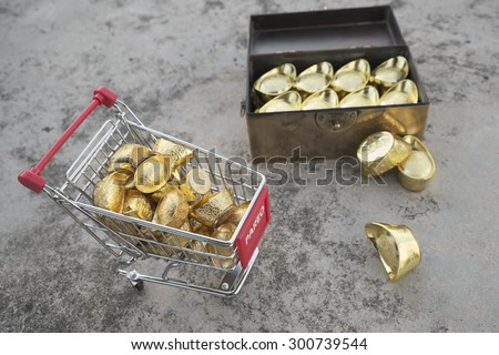 Abstract shallow DOF of gold transfering from treasure chest by pushcart with chineses word crafted on gold with meaning of good fortune, best of luck, and good health