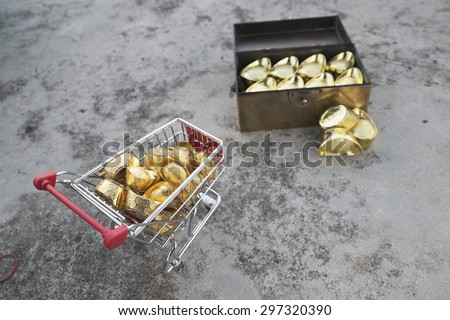 Abstract shallow DOF of gold transferring from treasure chest by pushcart with chinese word crafted on gold for good fortune, best of luck, and good health