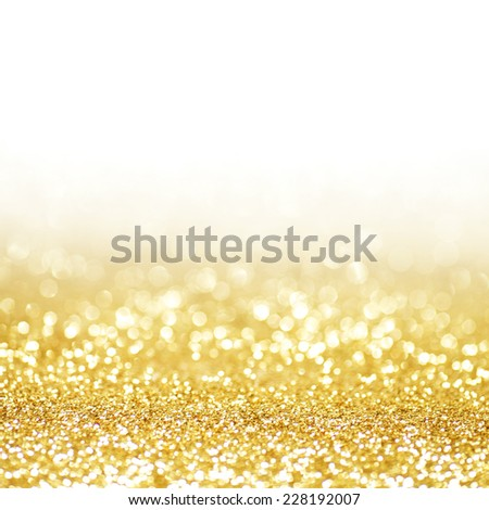 Abstract shining glitters gold holiday bokeh background with white copy space