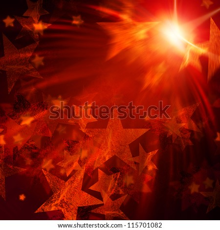 abstract shining stars with orange rays lights over dark background