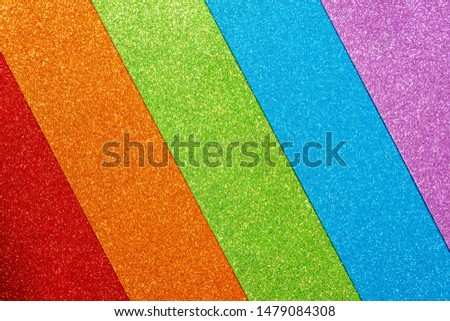 Abstract shiny colorful background. Red, orange, green, blue, purple glitter. A set of designer paper for decoration and design of Christmas, New Year or other holiday pictures. Beautiful packaging