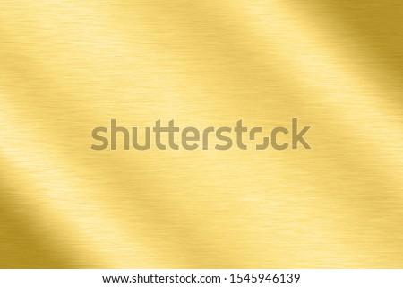 Abstract Shiny smooth foil metal Gold color background Bright vintage Brass plate chrome element texture concept simple bronze leaf panel hard backdrop design, light polished steel banner wallpaper. #1545946139