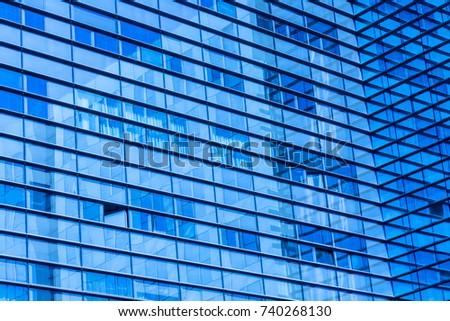 Abstract Shot Of Glass Transparent Skyscraper Office Building For Texture Or Background Blue Toned