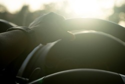 Abstract silhouette of  hand of man use wheel of car.